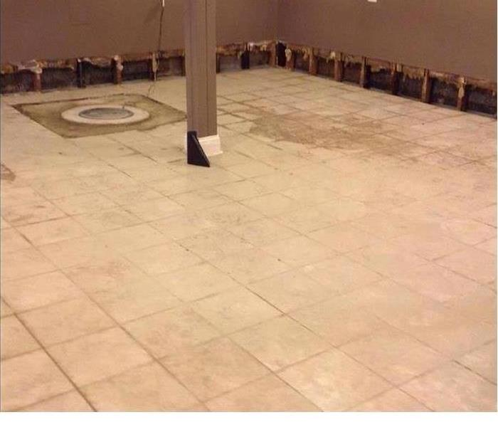 Tile floors damaged by flood waters
