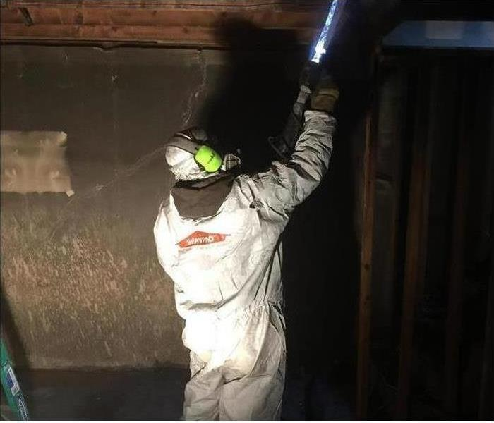 A technician dry ice blasting a fire damaged room.