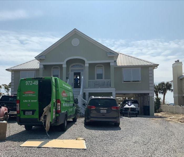 SERVPRO van parked outside a beach house in Alabama preparing to start a job.